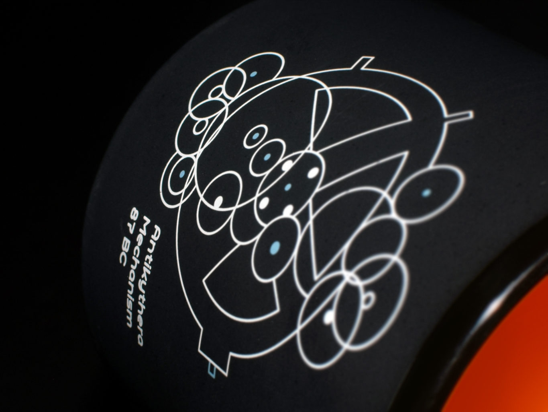 antikythyra logo design on a mug