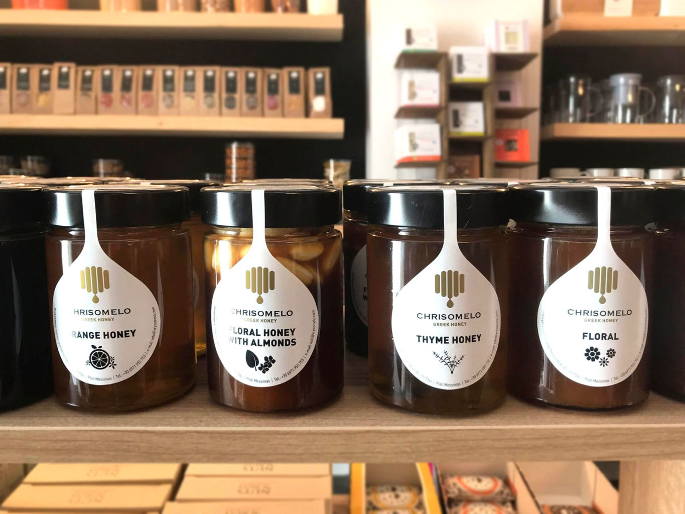 Chrisomelo honey packaging on wooden surface