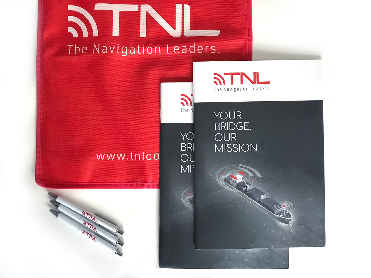 TNL Group printed catalogues, bag and pens